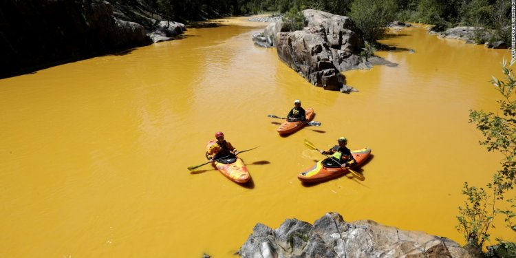 Kayakers float along the