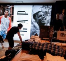 A worker arranges clothes at the GAP clothing retail store in Manhattan, New York
