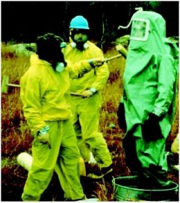 A worker is undergoing a decontamination process. (U.S. EPA. Reproduced by permission.)