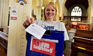 Becci North with the box where villagers are noting their random acts of kindness.