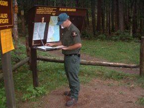 DEC forest ranger at trail head