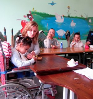 Female volunteer working with special needs children in Morocco