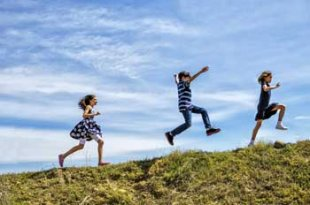kids running up a hill